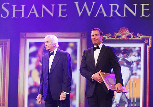 Shane Warne (right) stands with the legendary Richie Benaud
