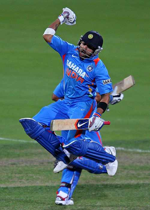 Virat Kohli celebrates after completing his century