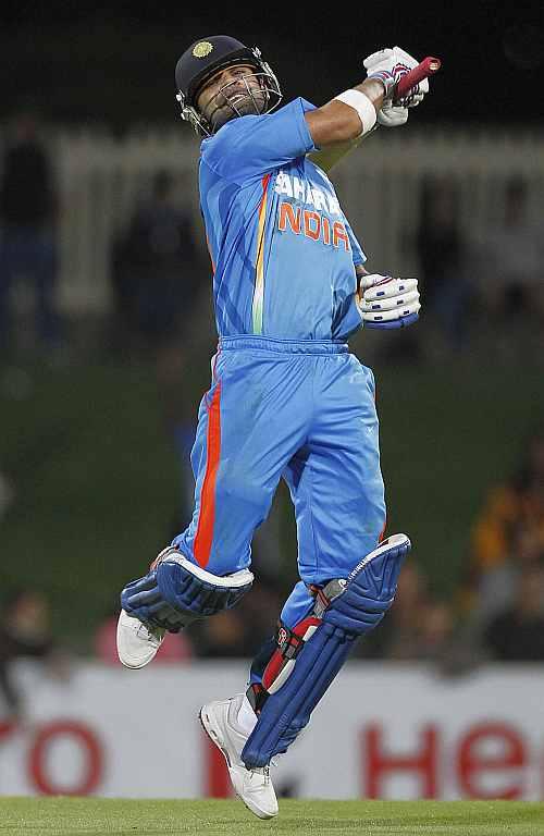 Virat Kohli celebrates after India defeats Sri Lanka in Hobart on Tuesday