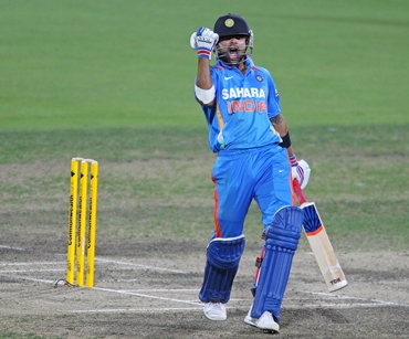 Virat Kohli celebrates after hitting the winning runs during the tri-series ODI between India and Sri Lanka at Bellerive Oval on Tuesday