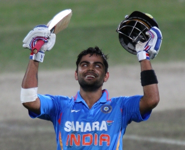 Kohli celebrates after his hundred