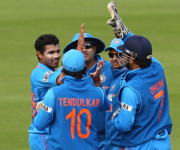 The Indian team celebrates the fall of a Sri Lankan wicket