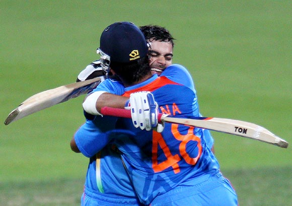 Virat Kohli celebrates with Suresh Raina after winning the Hobart ODI