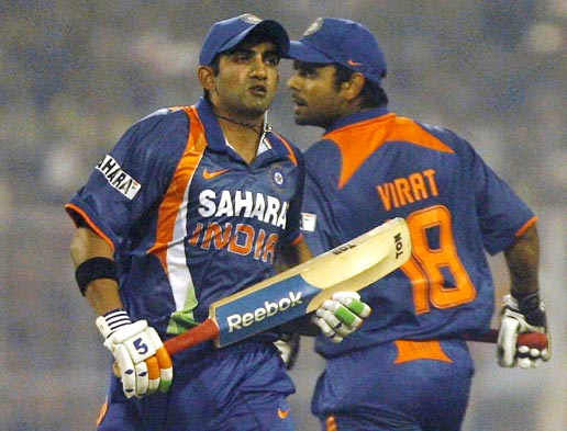 Gautam Gambhir (left) and Virat Kohli run between the wickets during their fourth ODI against Sri Lanka in Kolkata, on December 24, 2009