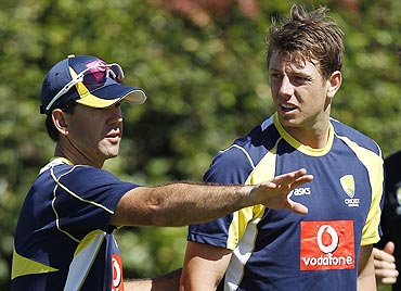 Australia's Ricky Ponting (left) talks to bowler James Pattinson during a practice session on Monday