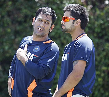 India's captain Mahendra Singh Dhoni (left) talks to teammate Virat Kohli during a nets session at the Sydney Cricket Ground on Monday