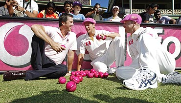 Former Australian fast bowler Glenn McGrath (left) poses with Brad Haddin (right) and James Pattinson during a McGrath Foundation event at the SCG on Monday