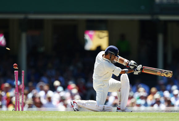 Sachin Tendulkar of India is bowled by James Pattinson