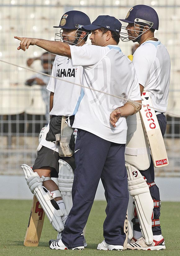 Sachin Tendulkar flanked by Gautam Gambhir, left, and Virender