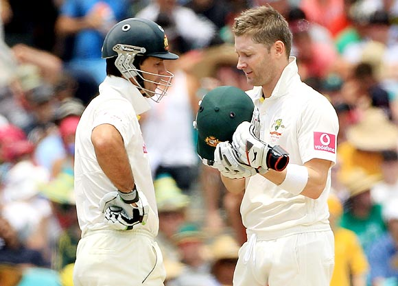 Michael Clarke (right) speaks with Ricky Ponting