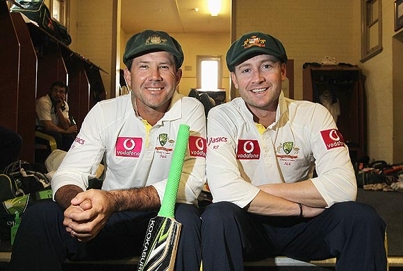 Ricky Ponting (left) and Michael Clarke celebrate in the dressing room after their 288-run partnership