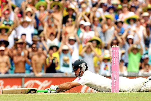 Ricky Ponting dives to bring up his century