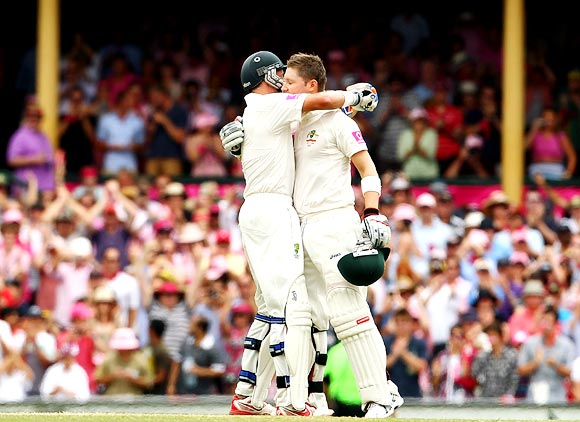 Michael Clarke (right) gets a hug from his partner Michael Hussey