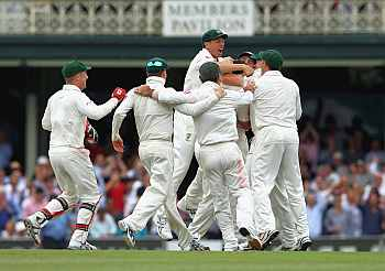 Australian players celebrate after winning the Test