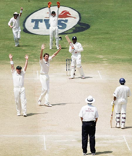 Glenn McGrath of Australia traps Virender Sehwag of India LBW during day four of the First Test between India and Australia