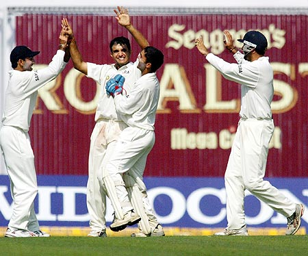 Indian cricket captain Sourav Ganguly is congratulated by team mates in Kolkata