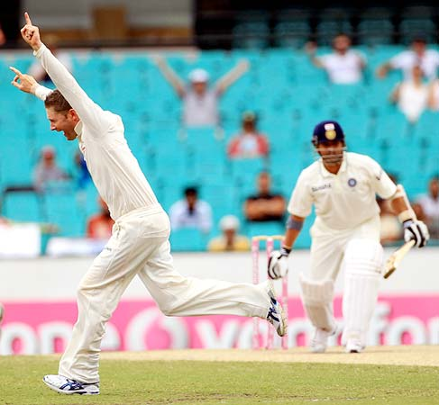 Michael Clarke celebrates getting the wicket of Sachin Tendulkar