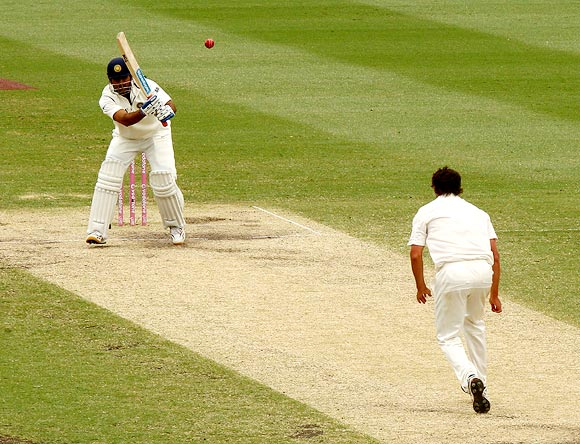Mahendra Singh Dhoni hits a return catch to Ben Hilfenhaus