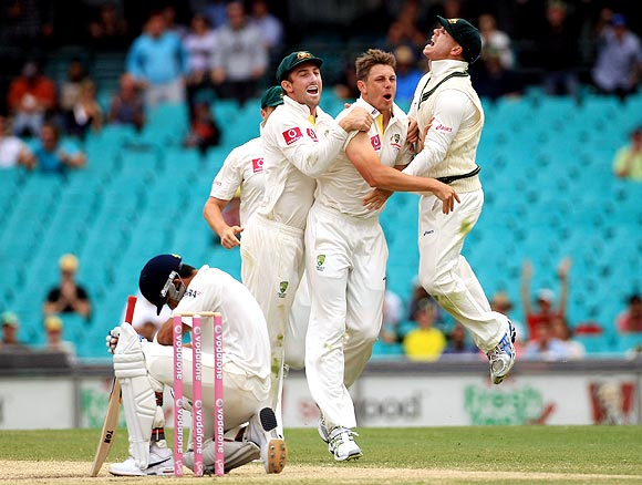Australian players celebrate as Virat Kohli wears a dejected look after his dismissal