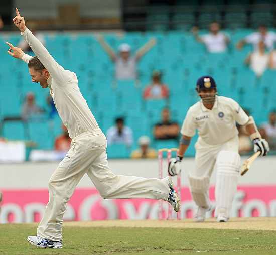 Michael Clarke celebrates after picking up a wicket of Sachin Tendulkar