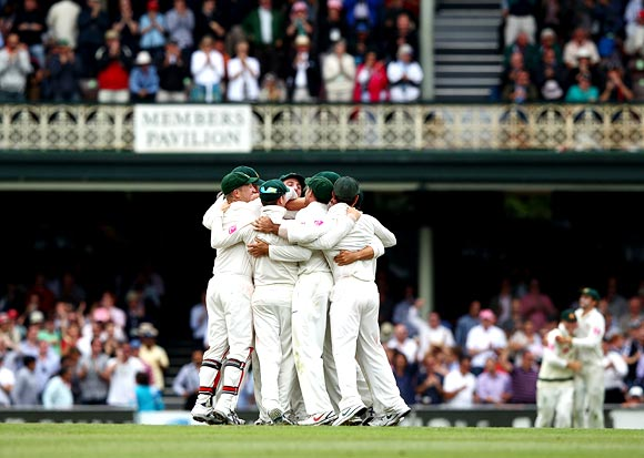 The Australian team celebrate after winning the second Test