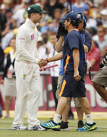 Australia's captain Michael Clarke (left) shakes hands with India's Sachin Tendulkar