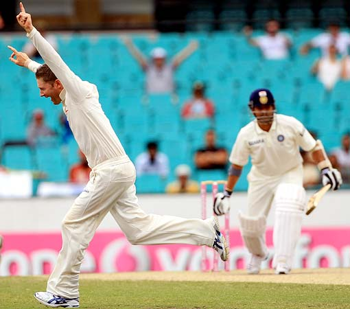Michael Clarke celebrates after taking the wicket of Sachin Tendulkar