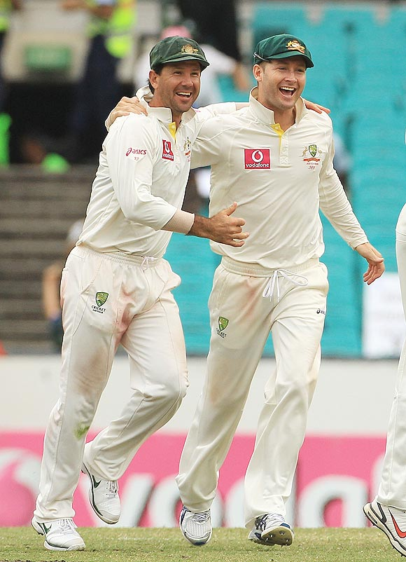 Ricky Ponting celebrates with Michael Clarke