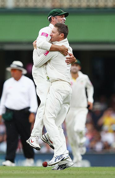 Michael Clarke and Michael Hussey celebrate