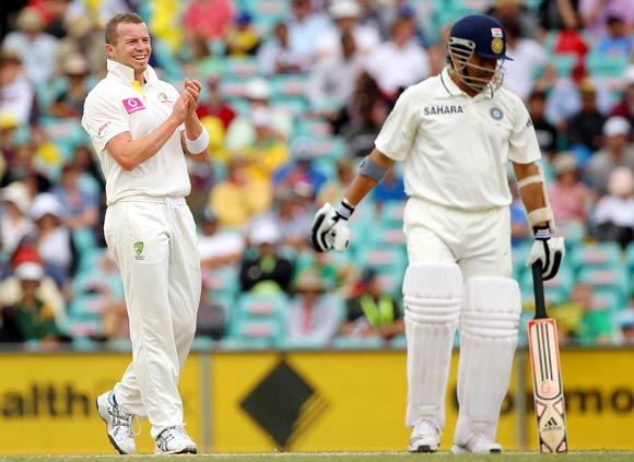 Peter Siddle looks at Sachin Tendulkar