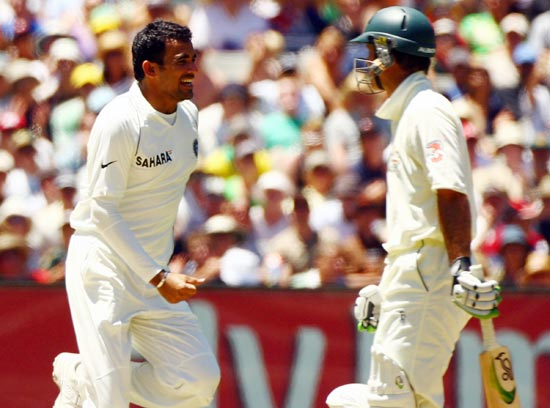 Zaheer Khan celebrates as Ricky Ponting walks back after his dismissal