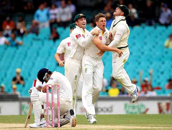 Australian players celebrate after picking up a wicket
