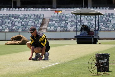 Curator Cameron Sutherland inspects the WACA pitch