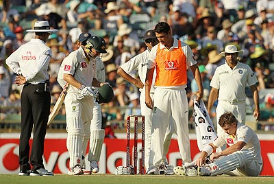 David Warner goes to ground after being struck on the head by Umesh Yadav