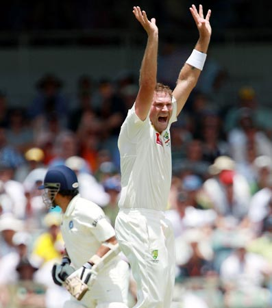 Ryan Harris celebrates after taking the wicket of Sachin Tendulkar
