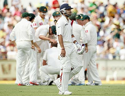 Virat Kohli of India leaves the field after being dismissed by Peter Siddle