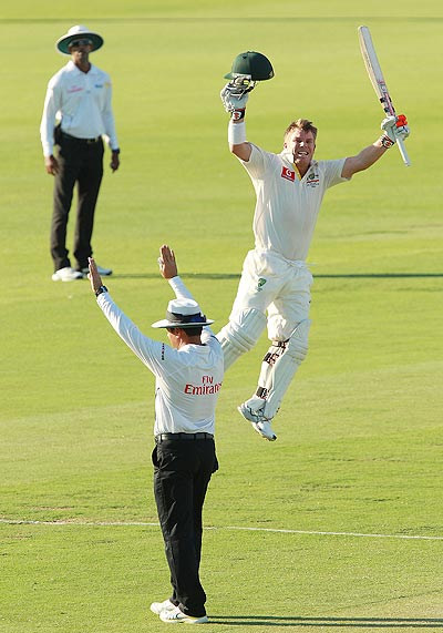 David Warner of Australia celebrates his century