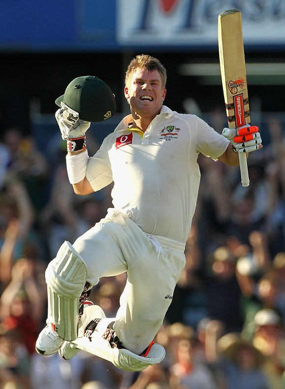 David Warner celebrates after getting to his hundred
