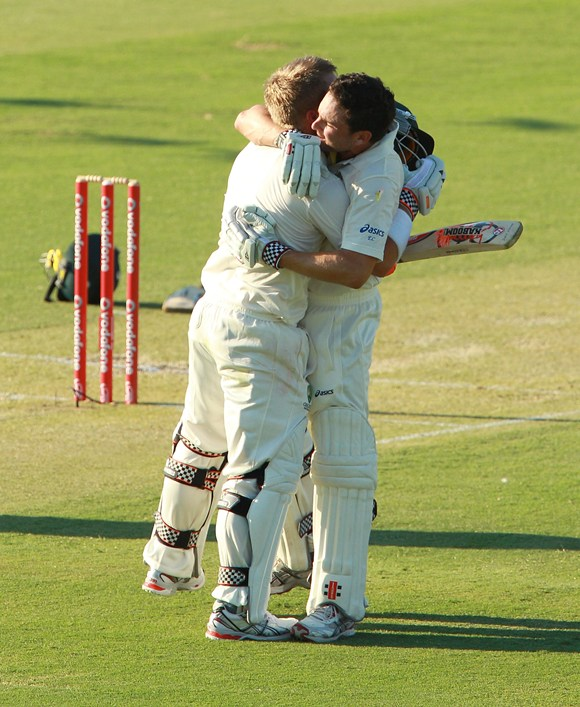 Warner is congratulated by Ed Cowan after his hundred