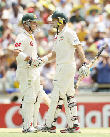David Warner (L) and Ed Cowan of Australia reache a 200 run partnership during day two of the Third Test match between Australia and India at WACA