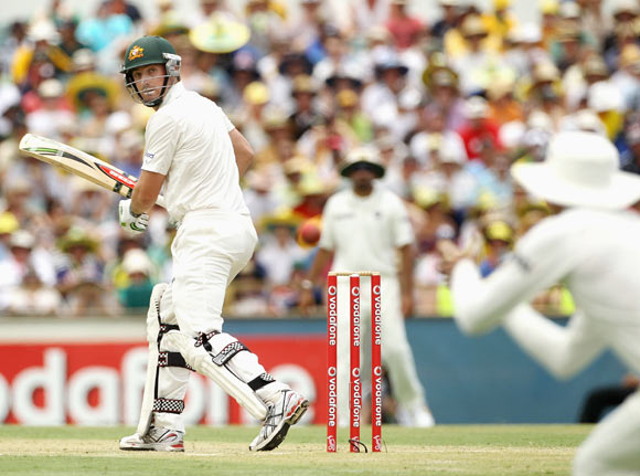 Shaun Marsh of Australia edges to be caught by VVS Laxman (R) of India from the bowling of Umesh Yadav of India during day two of the Third Test