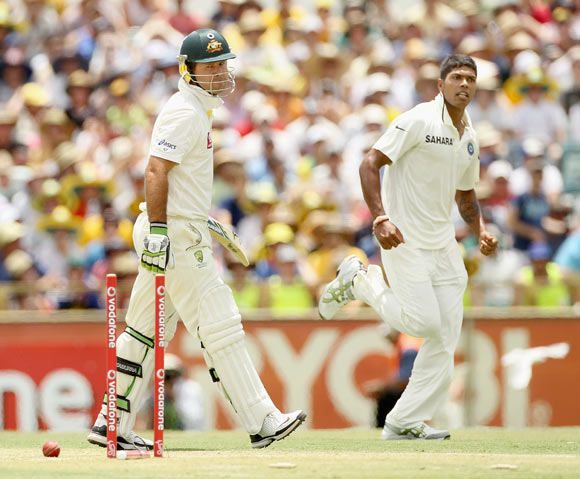 Ricky Ponting of Australia looks back at his stumps after being bowled by Umesh Yadav (R) of India during day two of the Third Test