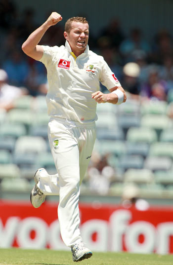 Peter Siddle of Australia celebrates dismissing MS Dhoni of India during day three of the Third Test match between Australia and India at the WACA