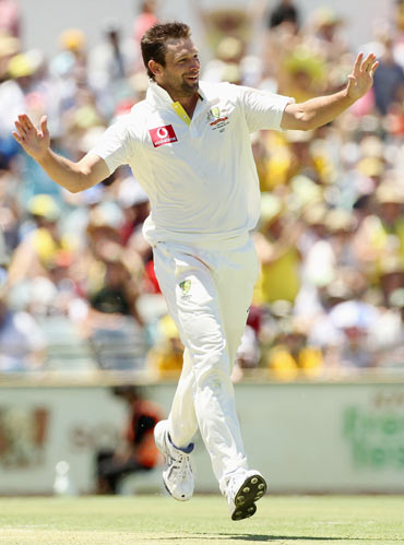 Ben Hilfenhaus of Australia celebrates the wicket of Zaheer Khan of India during day three of the Third Test match between Australia and India at WACA
