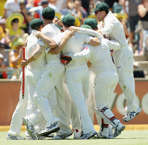 The Australian Team celebrate their victory during day three of the Third Test match between Australia and India at WACA