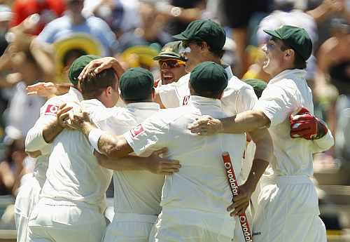 Australian players celebrate after winning the third Test against India