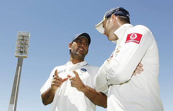 Australia's captain Michael Clarke (right) talks to India's captain Mahendra Singh Dhoni after Australia won the third Test on Sunday