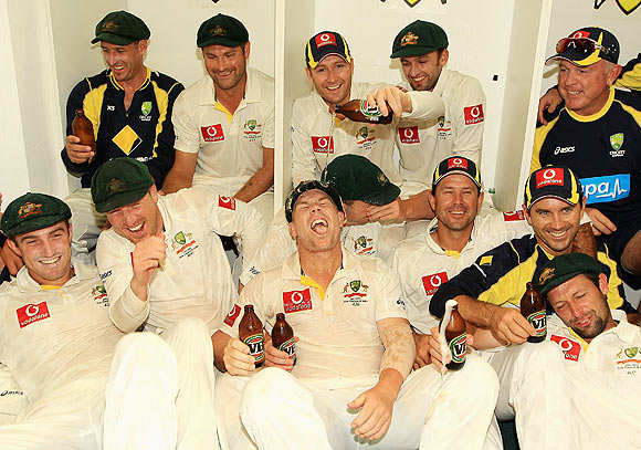 The Australian team celebrate in the dressing room after winning the third Test