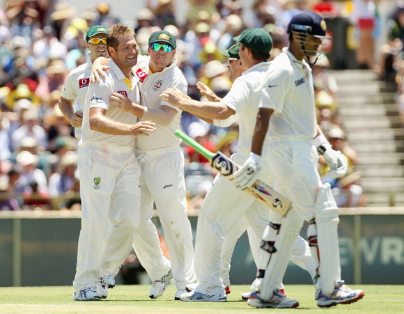 Ryan Harris of Australia celebrates with teammates after taking the wicket of Rahul Dravid of India during day three of the Third Test