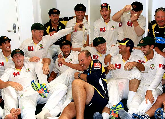 The Australian team celebrate winning the third Test in Perth